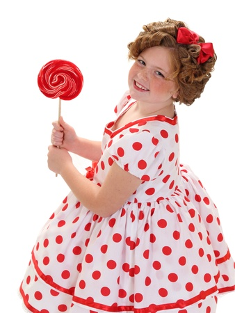 A young girl holds a red lollipop isolated on white Stock Photo