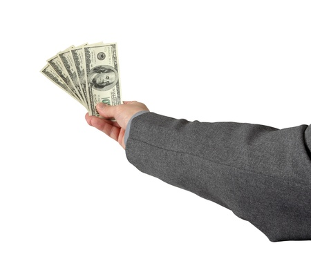 A businessman holds his bonus pay isolated on white