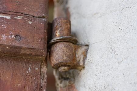 hinge: rusty hinge of a wooden door old Stock Photo