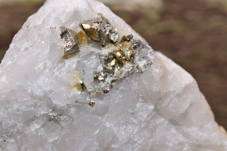 pyrite: pyrite and gold on quartz matrix