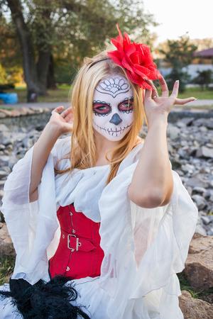 Portrait of beautiful girl in the image of Santa Muerte Stock Photo