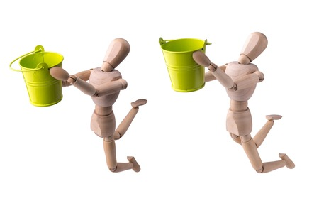 wooden bucket: Wooden model of the person with a bucket in hands on the white isolated background