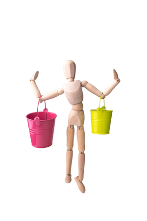 Wooden model of the person with a bucket in hands on the white isolated background