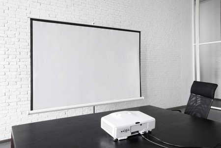 Blank projector canvas in the office Standard-Bild