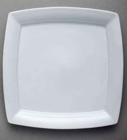 Ceramic Plate on gray background Stock fotó