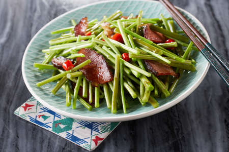 Delicious Chinese food, bacon stir-fried green vegetables