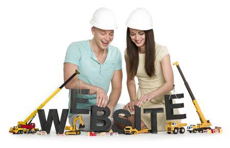 Website under construction: Joyful man and woman building website-word.