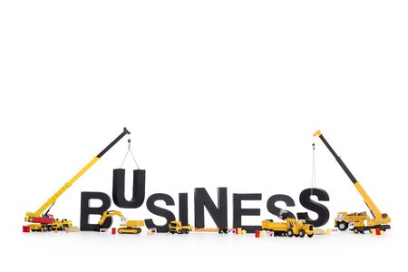 Build up a business: Machines building word. Stock Photo