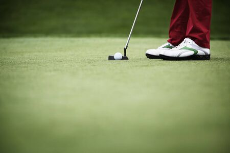 Close-up of golfer putting
