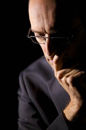 Portrait of contemplating businessman.