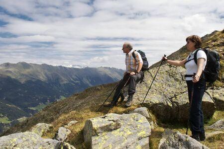 Hiker enjoying stunning view of the Alps Фото со стока