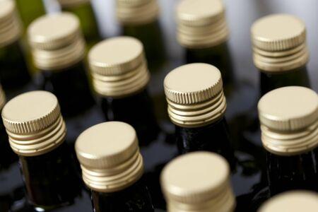 Metal screw caps on glass bottles.