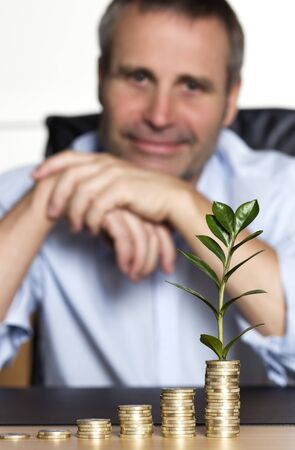 Happy businessman pleased about prosperous business growth.
