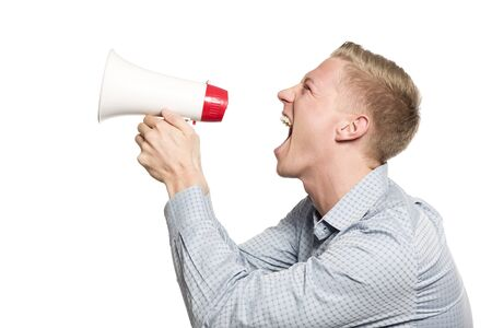 Furious businessman shouting with megaphone.