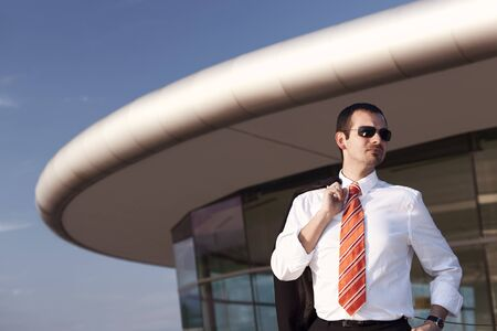 Cool businessman in front of office building. Stock Photo