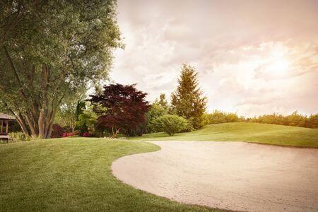 Golf fairway at sunset. 版權商用圖片