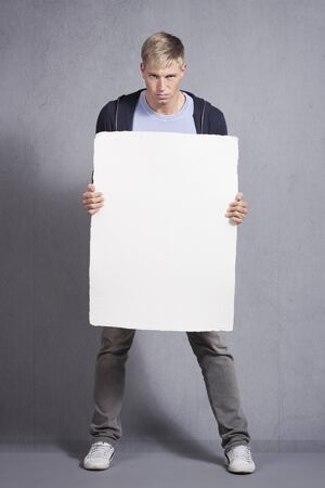 Angry man presenting white blank panel.