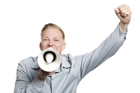Enthusiastic businessman shouting with megaphone.