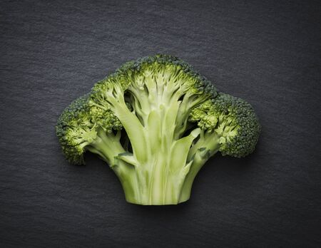 Cut through broccoli isolated on a stone slab. Stock fotó