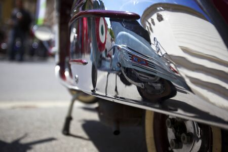 Mirror image of an Italian motorbike on the cover of another Italian scooter. Stock Photo