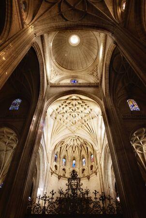 Upwards view at beautiful cupola above altar in church