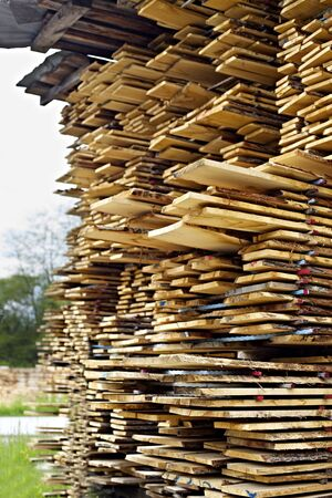 Stack of cut wood boards, side view.