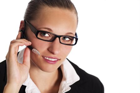 Close up of friendly female phone operator in call centre talking with headset to provide customer service, isolated on white background.