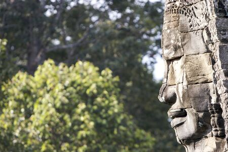 Profile of carved face on one of the 54 towers at Bayon temple, Angkor, Cambodia
