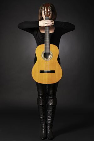 Woman with guitar as cross.