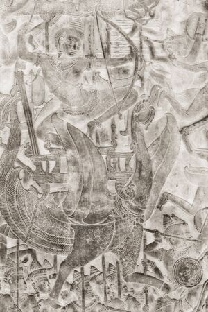 Relief of military scene, part of gallery of Angkor temple complex Stock Photo
