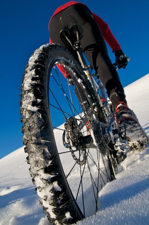 Winter Biking on snow-covered Austrian mountain photo
