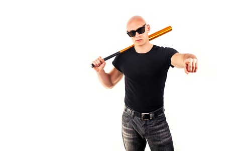 skinhead: Violence and aggression concept - furious screaming angry man hand holding baseball sport bat in black t-shirt