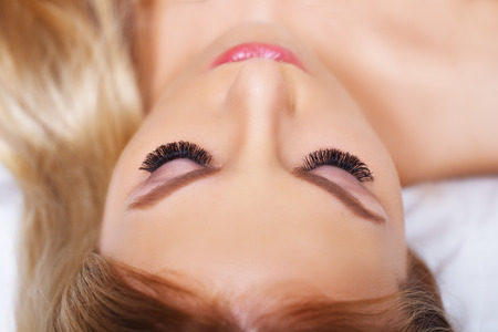 Beauty makeup for blue eyes. Part of beautiful face closeup. Perfect skin, long eyelashes. Make up concept. Stock Photo