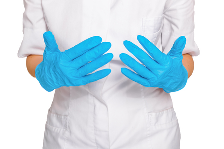 show of hands: Doctor show hands with sterile gloves isolated on white. Medical advertising concept.