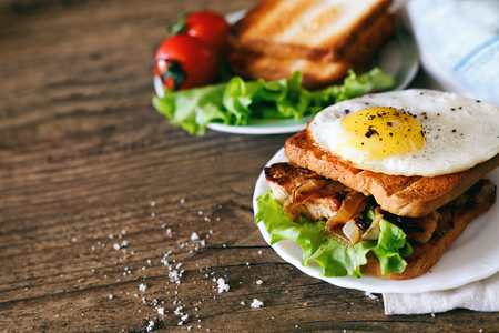 turkey bacon: Sandwich with eggs, chicken, cucumber and lettuce on a wooden background. Selective focus. copy space Stock Photo