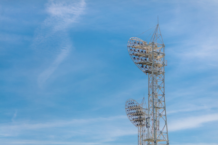 Stadium light against blue sky. Sports architecture and equipment. Stock Photo