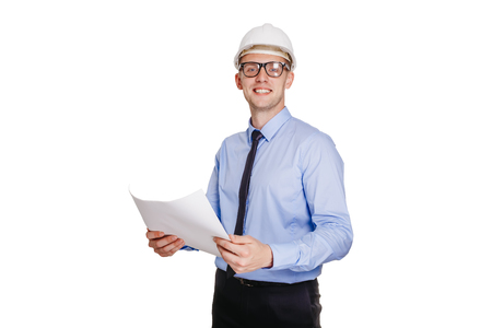 Handsom construction engineer with blueprint looking at the camera. Isolated on white. Stock Photo