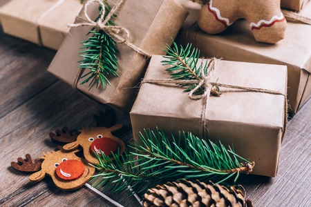 Christmas Gifts with Boxes on Wooden Background. Vintage Style. Closeup, selective focus.