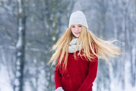 Winter young teen girl portrait. Beauty Joyful Model Girl laughing and having fun in winter park. Beautiful young woman outdoors. Enjoying nature, wintertime