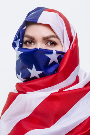 beautiful Sirian woman wearing a hijab from the American flag