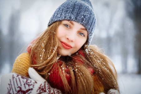 Winter young woman portrait. Beauty Joyful Model Girl laughing and having fun in winter park. Beautiful young female outdoors, Enjoying nature, wintertime 写真素材