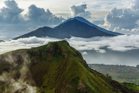 Active Indonesian volcano Batur in the tropical island Bali. Indonesia. Volcano sunrise serenity. Dawn sky at morning in mountain, travel concept