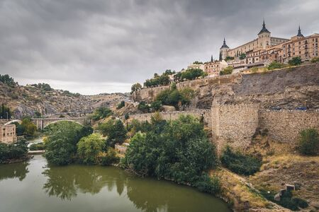 Panoramic view of Toledo old town with Alcazar castle at sunset, Castilla-La Mancha, Spain Stock Photo