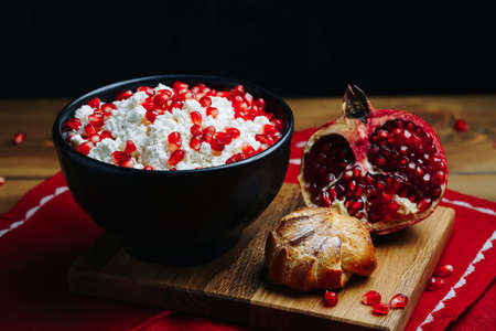 Cottage Cheese In Bowl. Homemade Curd Cheese Served With pomegranate seeds in a bowl. Healthy breakfast concept.