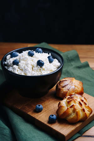 Cottage Cheese In Bowl. Homemade Curd Cheese Served With currant berries or blueberry. Healthy breakfast concept.