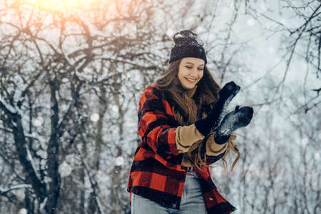 Winter young woman portrait. Beauty Joyful Model Girl laughing and having fun in winter park. Beautiful young female outdoors, Enjoying nature, wintertime Reklamní fotografie