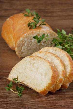 baguet: Tasty French baguet with a fresh thyme.