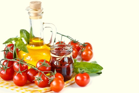Fresh and dried cherry tomatoes in an olive oil with spices and basil. photo