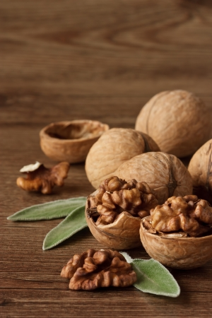 nut shell: Walnuts with leaf on a wooden table. Stock Photo