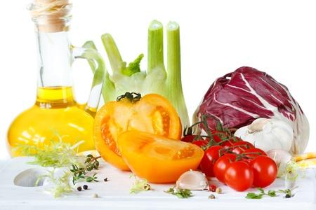 escarole: Fresh garden vegetables for diet on a white wooden board. Stock Photo